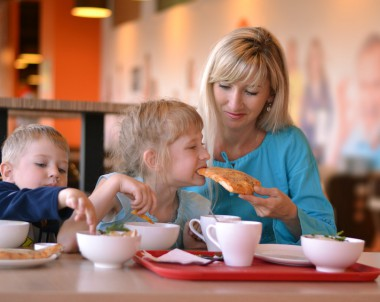 The young woman and two children eat in cafe © snpolus - Fotolia.com
